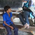 Dr Nahid doing dental screening